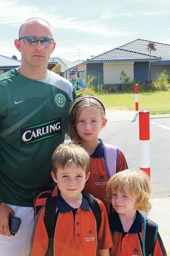 Parent and policeman Chris Maden, pictured with his children, said Meadow Springs PS had the worse school zone he had seen.