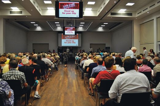 A crowded South Perth Community Hall where speakers on the controversial topic of local government reform included City of South Perth Mayor Sue Doherty.