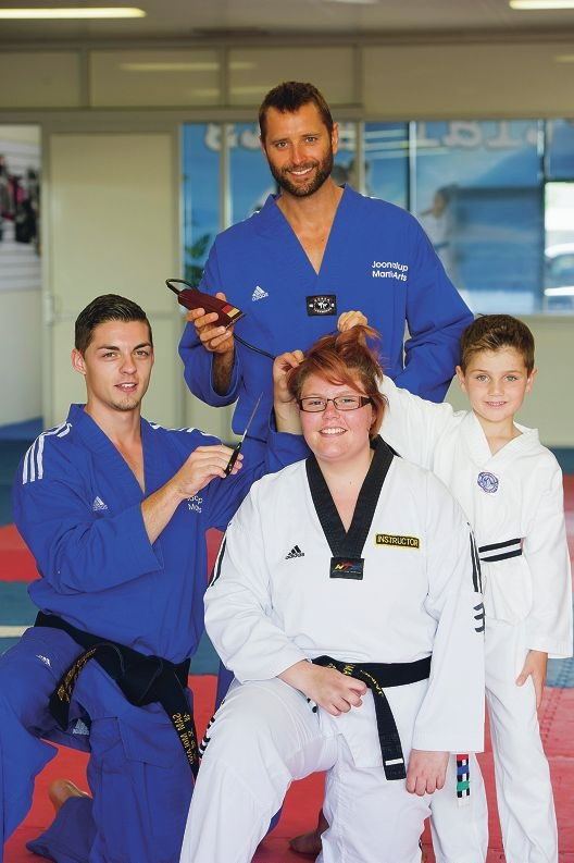 Jaimee Stott with Joondalup Martial Arts intructors/owners Sam Moland and Colin Luthwood and student Riley Hales. Picture: Emma Reeves www.communitypix.com.au d416671