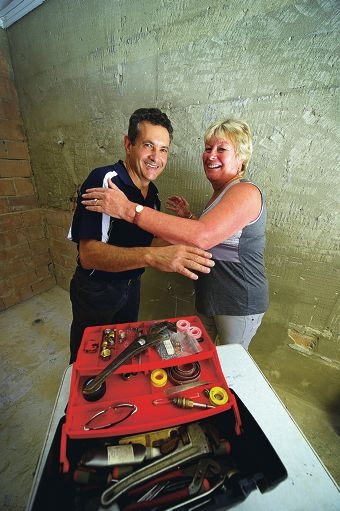 Julie Stanley prepares to give plumber Phil Roggio a hug. Picture: Emma Reeves d416423