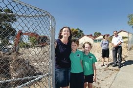 Victory: Nikki Bowyer with her children Luke and Erin, Fremantle MLA Simone McGurk and Beaconsfield PS principal John Worthy. Picture: Martin Kennealey www.communitypix.com.au d416342