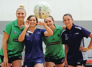 West Coast Fever players, from left, Courtney Bruce and Khao Watts with SEDA students, from left, Issy Valuri (17) and Ashley Sharp (16) [NAMES OK]