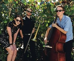 Big band members (from left) vocalist Holli Scott, trombonist Anthony Dodos and double bass player Alistair Peel.