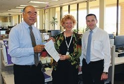 Moore MHR Ian Goodenough with Community Vision Inc CEO Jenni Werne and Jan Norberger MLA.