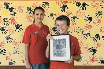 Head Girl Jodie Ellin and prefect Daniel Kerr with a picture from the past.