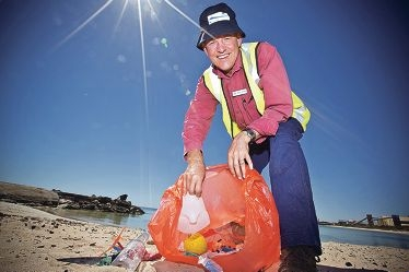 Coastcare Coastal and Marine manager Craig Wilson with a bag of beach rubbish. Pictures: Louise White d415942