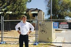 Bassendean MLA Dave Kelly is outside the abandoned department of housing units [NAMES OK]