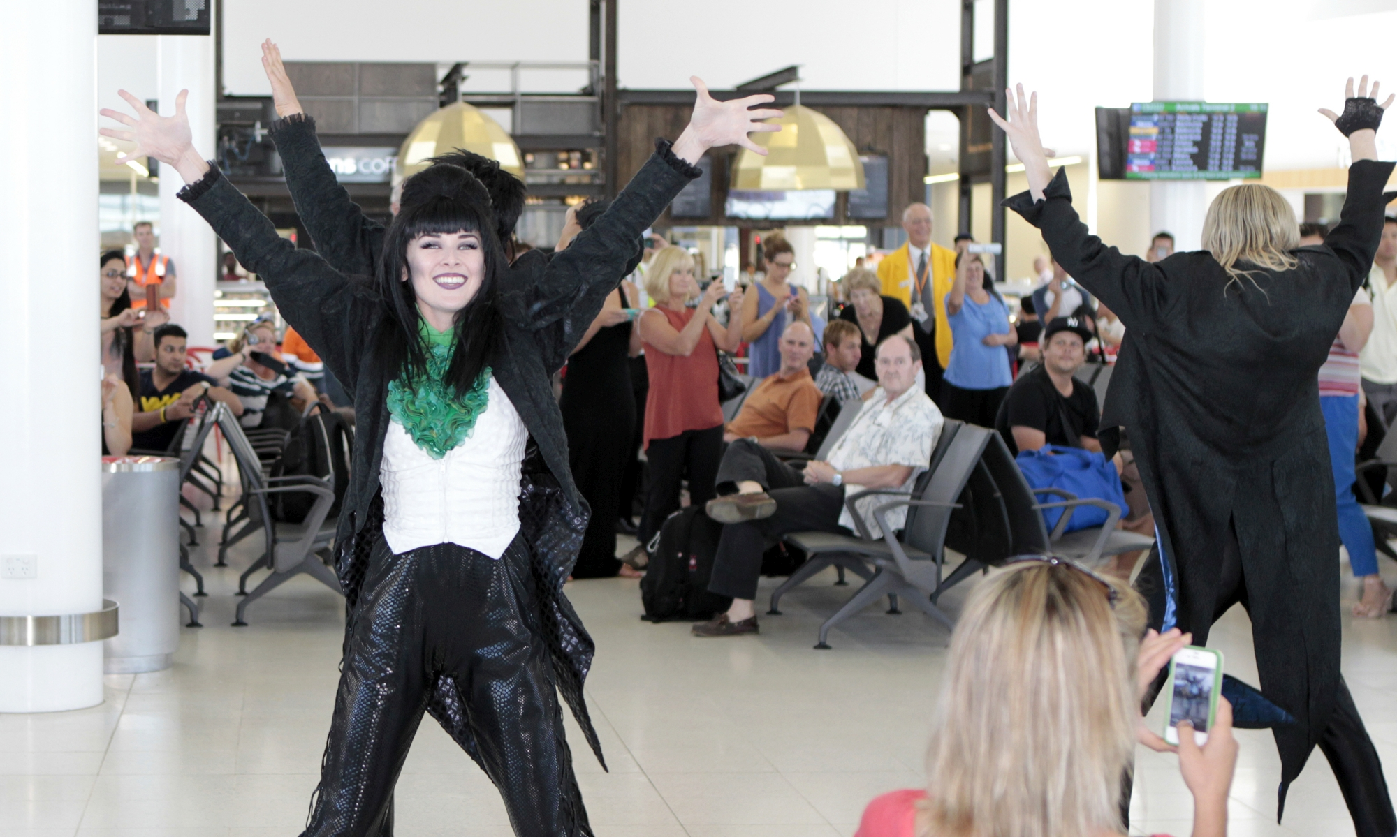 Visitors to Terminal 2 at Perth Airport got a live reminder of the mantra made famous by the 1975 cult movie The Rocky Horror Picture Show as performers from Richard O'Brien's Rocky Horror Show – on now at Crown Theatre – erupted into song and dance onsite last Tuesday.