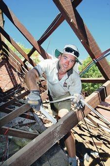 Carpenter Stew Sant does roofing work on the the former church, now home to the Kalamunda Dramatic Society. d415762