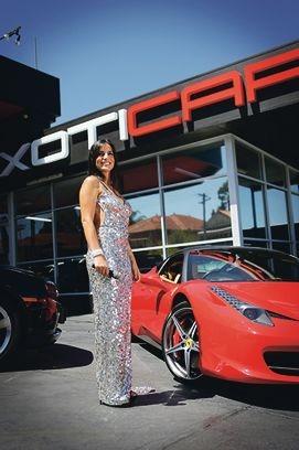 Performer Nez Erok in a Ruth Tarvydas gown and with a Ferrari 458 at Xoticar.
