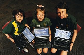 Inglewood Primary School Year 7 students, from left, Caleb Thompson Fanciulli [NO HYPHEN], Lucy Sutherland and Ronan McEwan composed music on laptops using bespoke software [NAMES OK]