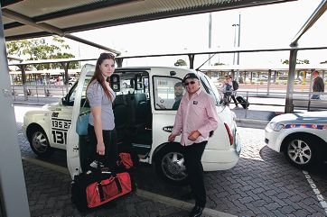 Passenger Tess Bacic with cabbie Phil Buhagiar from LCAB.