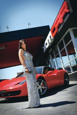 Performer Nez Erok, wearing a Ruth Tarvydas gown, in front of a Ferrari 458 at Xoticar. Picture: Andrew Ritchie www.communitypix.com.au d415303