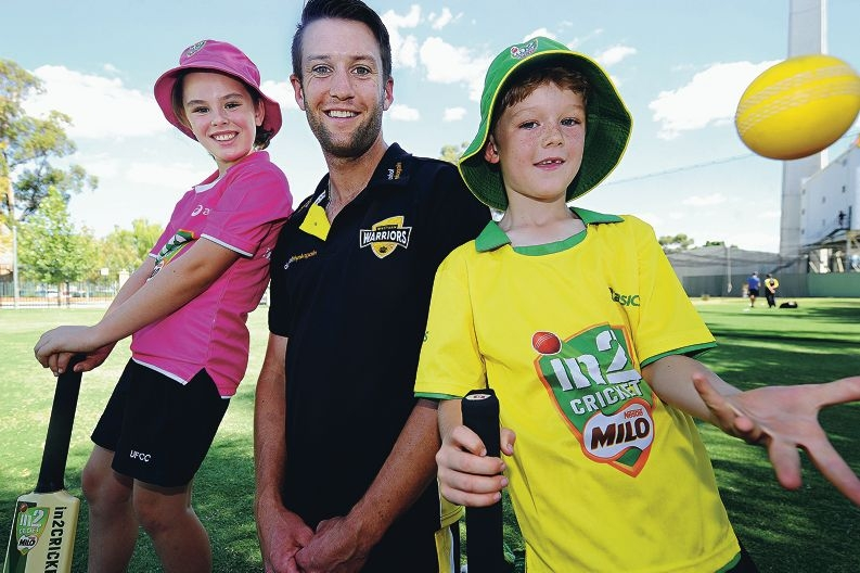 Western Warriors cricketer Andrew Tye with East Victoria Park siblings Olivia (10) and Thomas Greenway (8) [NAMES OK]