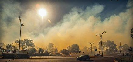 The bush fire created a hazy smog near Grand Boulevard and burnt across 1ha of land.
