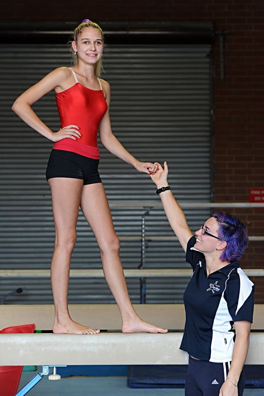 Gymnast and Mount Lawley Senior High School student Vanessa Vlajkovic (16) with her coach Michelle Ranieri. Picture: Marcus Whisson www.communitypix.com.au d415103
