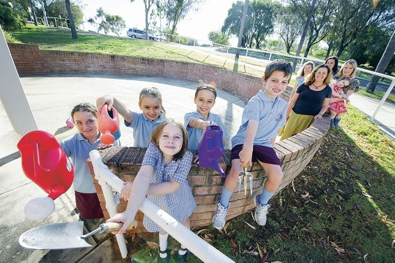 Front: Kayla Palmer, Jasmin Palmer, Charlotte Dwyer, Ruby Palmer and James Dwyer, Back: Sue Bailey, Heather Borle, Lisa Palmer and Sophie Dwyer with daughter Emily at the site of the proposed community garden. Picture: Emma Reeves d415545