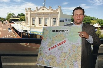 Bassendean Mayor John Gangell with a map of the proposed boundary changes.