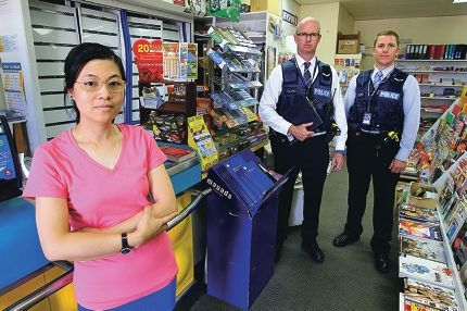 Shop owner Ivy Huang with Armadale Detective contables Simon Watson and Chad Stone. Picture: Marcelo Palacios d415283