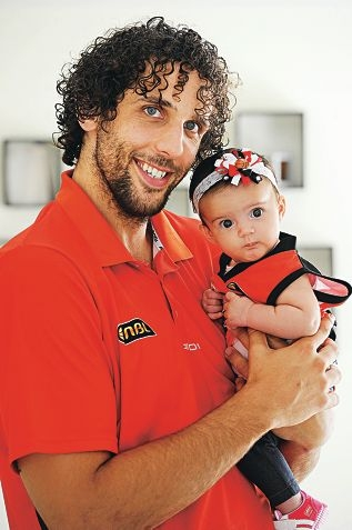Wildcats player Matt Knight with his adorable baby daughter Mia. Picture: Marcus Whisson www.communitypix.com.au d415237