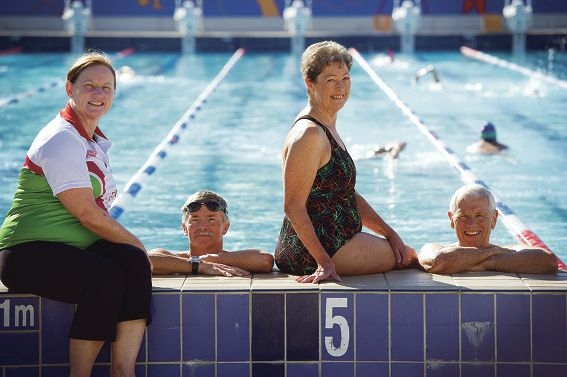Coach Kerry Hodson with Carine Masters Swimmers David Davies and Jane and David Laws. Picture: Emma Reeves d415019