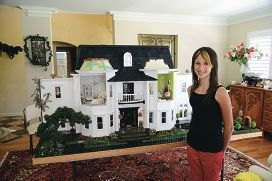 April Hunton with the manor she helped build, which will be used to help raise funds for Cystic Fibrosis WA.