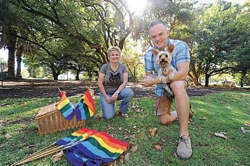 Pride co-presidents Michelle Rigg and Daniel Smith with his dog Sofie.