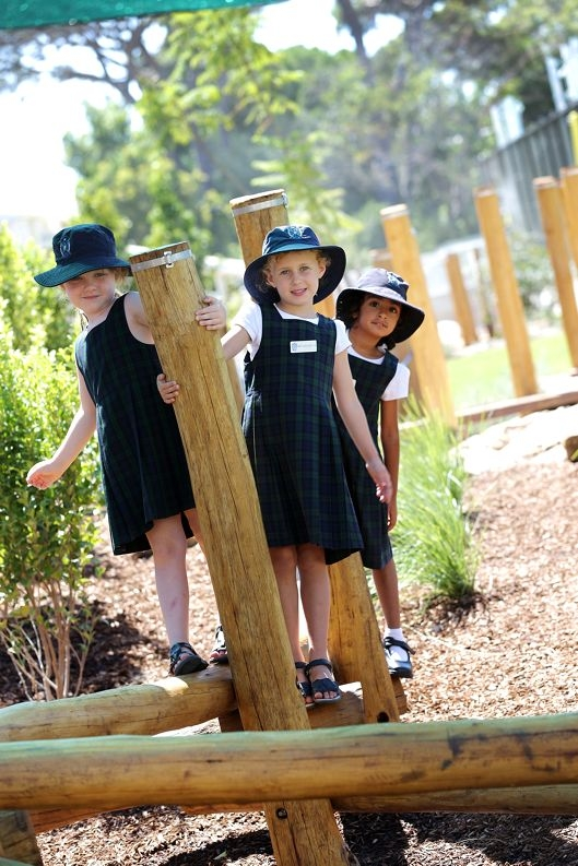 Year 1 students Natasha Whittome, Matilda Burton and Nikita Chaba try out the new nature-based playground at the junior school. Picture: Andrew Ritchie www.communitypix.com.au d414994