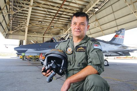 Wing Commander John Young in front of his Hawke 127 jet trainer. Picture: Bruce Hunt d414570