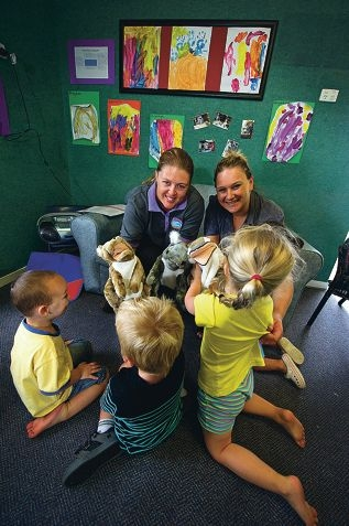 From Left: Kath Finney (Pre-School teacher), Tash Browne (Director) with children Riley Ballantyne (3 yrs), Tai Simms (2 yrs), Elizabeth Speer (3 yrs), Jazmine McMahon (3 yrs, yellow). The Goodstart runs 'play and learning' programs for children and recently received government funding for a PALS kits which includes puppets, workbooks, etc.