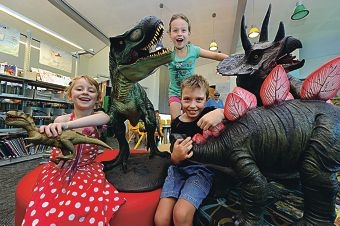 Rosie and Abby Stott with Blake Turner and their favourite dinosaurs at Jurassic January in Bassendean Library. Picture: Marcus Whisson www.communitypix.com.au d414063