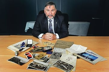 RSL State Secretary Phil Orchard with the World War II material. Picture: Marcus Whisson www.communitypix.com.au d414081