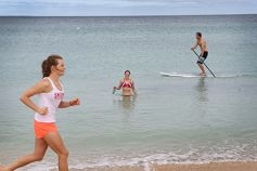 Michael Prosser (back), Amie Montefiore and Lucy Gunzburg prepare for the Cottesloe to Swanbourne Ocean Classic. d414324
