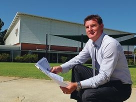 Swan Valley Anglican Community School principal Jason Bartell with plans for the school.