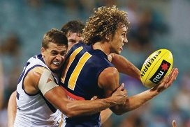 Docker Stephen Hill tackles Eagle Matt Priddis in last year's pre-season derby clash. Picture courtesy Michael Dodge/Getty Images
