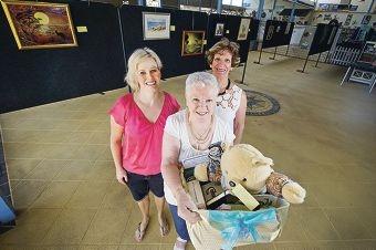 Karen Petrovski, Rita Cowan and Elvira Ingram provided some of the New Ventures Art Group's works. Picture: Emma Reeves www.communitypix.com.au d413645
