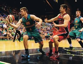 Greg Hire puts pressure on Townsville's Mitch Norton during the Wildcats win over Townsville on Sunday.