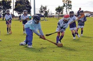 Gaelic Games Junior Academy hurlers in action.