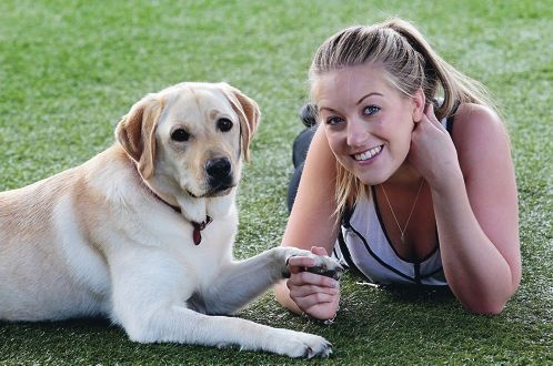 Casey McCrae, with Goldie, has acted as a boarder for three trainee guide dogs. Picture: Martin Kennealey www.communitypix.com.au d413791