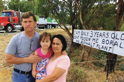 John Ferrier and his wife Jane,with Alison (3), who live next door to the quarry believe the temporary plant may become a permanent fixture. Picture: Marcelo Palacios www.communitypix.com.au d413843