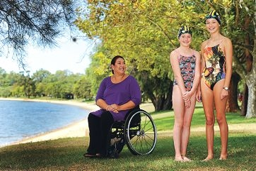 Former paralympian and WA Disabled Sports Association president Priya Cooper with UWA Uniswim Swimming Club members Maggie (12) and Claire Maloney (14)