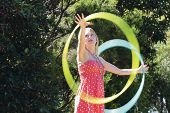 Soul Hula owner Shannie Healy shows off her hula hooping skills.