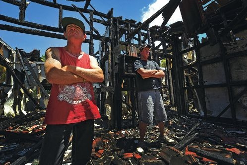 Andrew Clinkers and Michael Bobnar outside their razed squat. Picture: Jon Hewson d413390