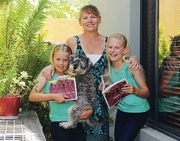 Author Julie Meek with daughters Elise and Indi and dog Lulu. Picture: Marcus Whisson www.communitypix.com.au d413422