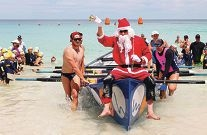 Members of the Mullaloo Surf Lifesaving Club set off at the start of the annual Ted Scott Marathon, which ended when Santa (pictured below) was rowed to shore. Pictures: Ashleigh Traill