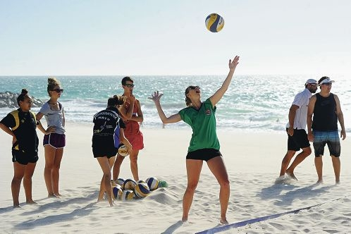 Tyana Johnson (15,) practises her serve on City beach. Picture: Marcus Whisson www.communitypix.com.au d413103