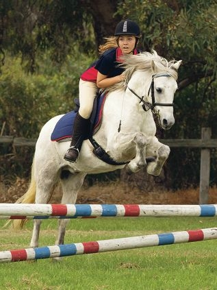 Luisa Dry puts her pony over some jumps.
