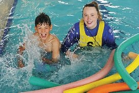VacSwim instructor Gen Lamond with one of her students Jordan Flatman.
