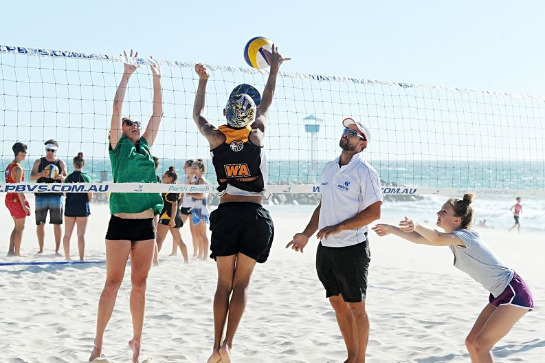 Perth Beach Volleyball School director Marty Suan coaching elite students, from left, Tyana Johnson (15, Attadale), Riley Fissioli (12, Landsdale) and Janais Moloney (13, Wembley Downs) [NAMES OK]