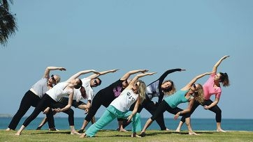 Waves Yoga By The Sea instructor Leigh Jarrett with a class. Picture: Martin Kennealey d411617